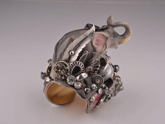 Terry Munter often uses damaged, salvaged elements in her wearable jewelry pieces, using up to six types of glue to ensure her assemblages hold together.