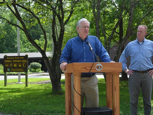 Gov. Jay Nixon holds a briefing outside the lodge at