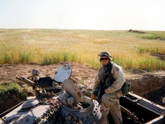 Patrick Weber helps perform bomb damage assessment for the Air Force in 2003. Weber, now 47, has post-traumatic stress disorder due to his experiences in war.