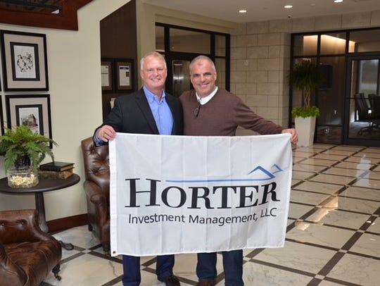 Drew Horter and Matt Brennan with the banner Brennan
