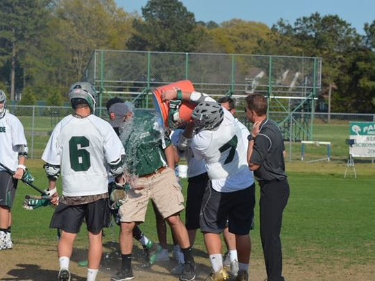 Jeremy Michalski gets a Gatorade bath following his 200th victory with the Parkside lacrosse team.