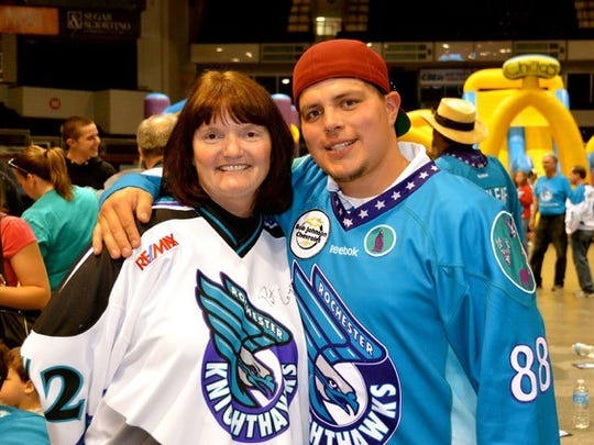 Knighthawks fan Sandie Dron, left, and star Cody Jamieson.