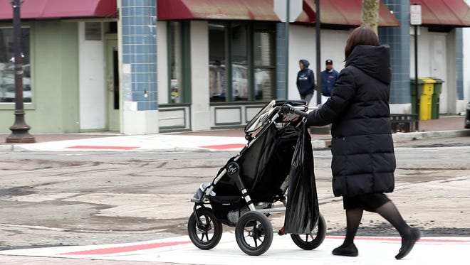 A woman pushes a stroller in Lakewood.