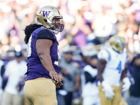 Washington defensive lineman Vita Vea reacts after