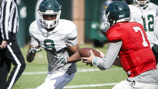 MSU freshman receiver Donnie Corley receives a handoff from QB Tyler O'Connor during Tuesday's practice. If the season began today, MSU's coaches say, Corley would be on the field.