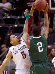 New Mexico State's Matt Taylor gets a clean block on