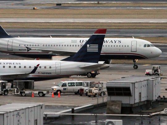 US Airways planes are shown last year at Philadelphia International Airport.