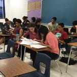 Clint Early College Academy students take an online government course.