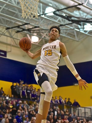Jaxson Hayes winds back for an emphatic one handed dunk against Elder Friday, January 26th at Moeller High School