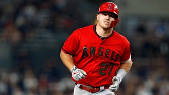 May 26, 2018; Bronx, NY, USA; Los Angeles Angels center fielder Mike Trout (27) rounds the bases after hitting a two-run home run against the New York Yankees during the fourth inning at Yankee Stadium.