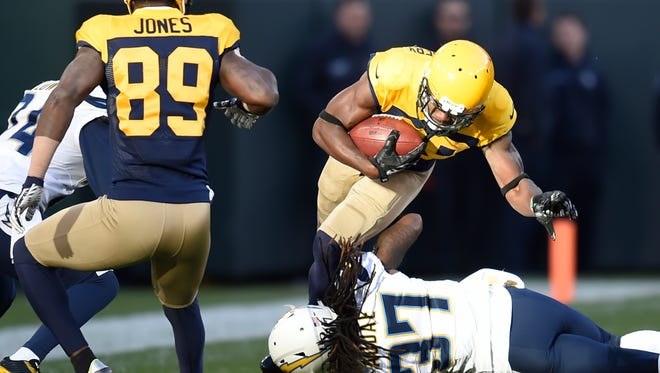 Packers wide receiver Ty Montgomery (88) is tackled by Chargers strong safety Jahleel Addae.
