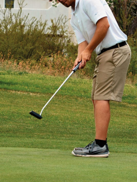 Matt Hollinshead — Current-Argus 2015 Cavemen golf graduate Brad Beeman practices putting on the 14th green Tuesday at Lake Carlsbad Golf Course. Beeman will continue his golf career at New Mexico Junior College in Hobbs.