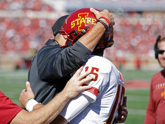 Iowa State coach Matt Campbell hugs Brock Purdy (15) after scoring a touchdown during the first half of an NCAA college football game against Texas Tech, Saturday, Oct. 19, 2019, in Lubbock, Texas. (Brad Tollefson/Lubbock Avalanche-Journal via AP)