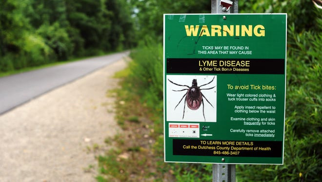 Information on the prevention of Lyme disease and other tick-borne diseases is displayed on the Dutchess County Rail Trail in the Town of LaGrange in this 2015 file photo. Researchers at the Cary Institute of Ecosystem Studies have targeted more than 5,000 neighborhoods in Dutchess County for a 5-year study aimed at killing ticks and reducing Lyme rates.