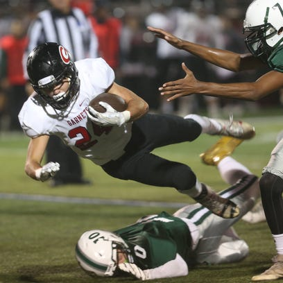 Rye's James Chabot gets tackled by  Brewster's Rob