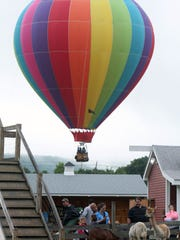 People enjoy the Hudson Valley Hot-Air Balloon Festival