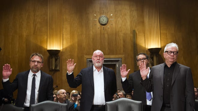File photo shows, from left, Backpage.com CEO Carl Ferrer, former owner James Larkin, COO Andrew Padilla and former owner Michael Lacey being sworn in on Capitol Hill in Washington, D.C., in January prior to testifying before the Senate Homeland Security and Governmental Affairs Permanent subcommittee hearing into Backpage.com knowing facilitation of online sex trafficking.Ferrer, Lacey and  Larkin are among those who are target of a new lawsuit.