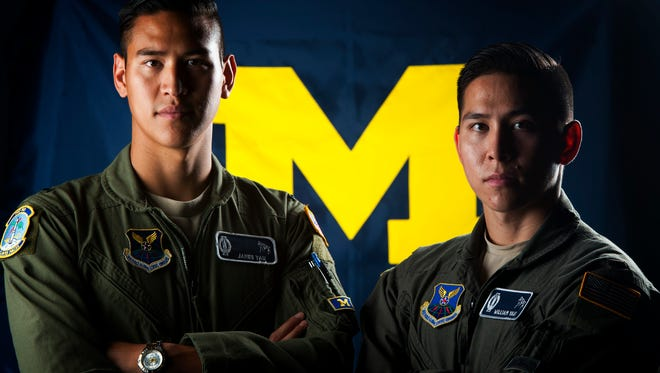 First Lt. James Yau (left) and 2nd Lt. William Yau, both 742nd Missile Squadron deputy missile combat crew commanders, stand next to each other at Minot Air Force Base, N.D., July 28, 2017. William Yau has looked up to his older brother as a mentor his entire life, and has followed his footsteps through high school, college and now the Air Force.