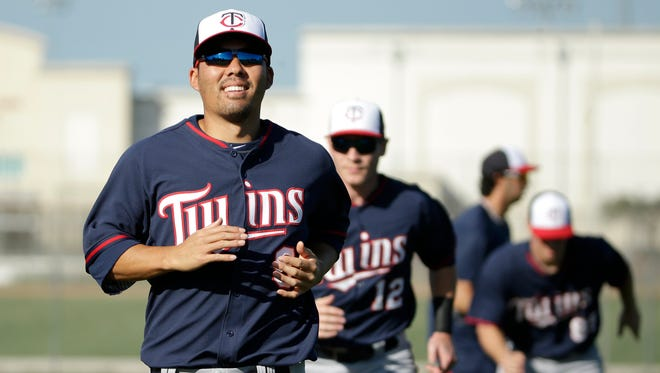 Kurt Suzuki expects to have close to an everyday role in Minnesota.