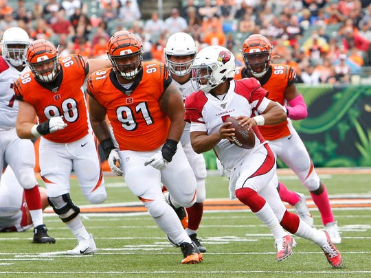 Oct 6, 2019; Cincinnati, OH, USA; Arizona Cardinals quarterback Kyler Murray (1) runs against Cincinnati Bengals defensive tackle Josh Tupou (91) during the first half at Paul Brown Stadium. Mandatory Credit: David Kohl-USA TODAY Sports