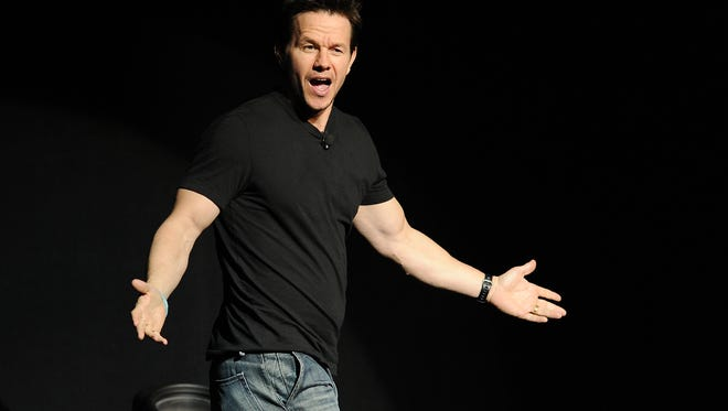 "Mark Wahlberg, star of the upcoming film ""Transformers: Age of Extinction,"" arrives onstage at the Opening Night Presentation from Paramount Pictures at CinemaCon 2014 on Monday, March 24, 2014, in Las Vegas."
