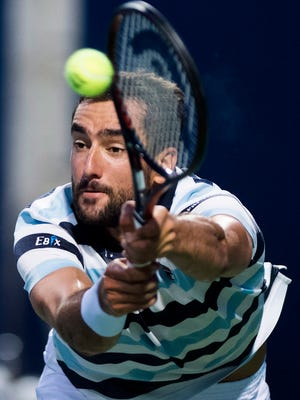 Marin Cilic, of Croatia, returns the ball against Rafael Nadal, of Spain, during quarterfinal men's Rogers Cup tennis action in Toronto, Friday, Aug. 10, 2018. (Nathan Denette/The Canadian Press via AP)