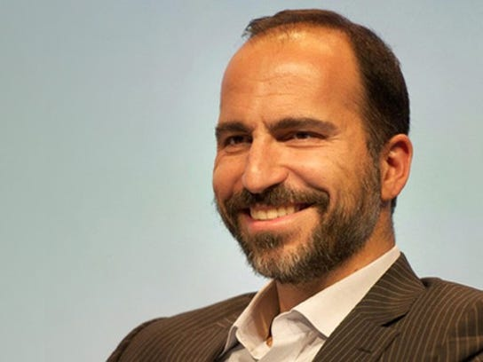 A headshot of Khosrowshahi, smiling.