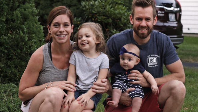 Sarah and Ryan Smith of Cranston, R.I., hold daughters Ashton, 2, and Eden, 6 months. Both of the Smiths took paid family leave when Eden was born. Rhode Island is one of three states with paid family leave programs.