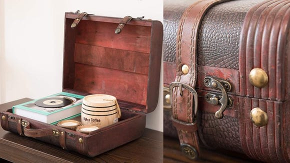 This suitcase isn't built for travel or longterm storage, but it's a cute way to keep your displayable knick-knacks tidy.