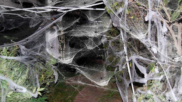 Whether it's encasing your whole walkway in webbing or adding a few strands to a light fixture, fake spider webs are necessary for nailing that Halloween feeling.