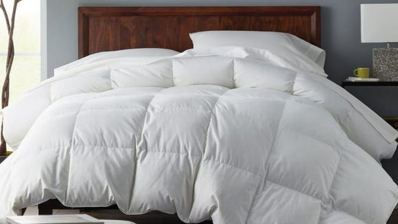 This luxurious down comforter is lofty and warm.