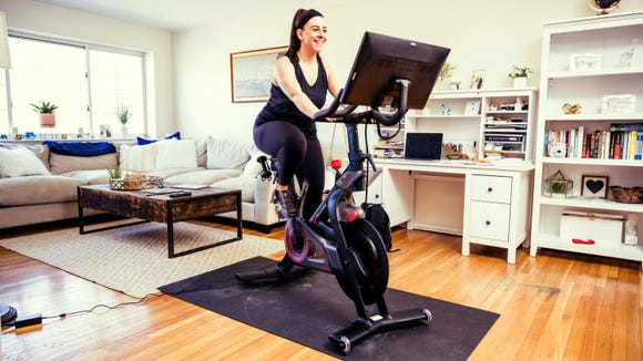 Getting a Peloton indoor bike is like installing a spinning studio in your living room.