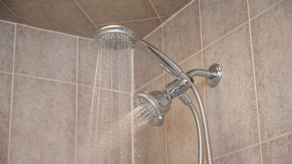 This showerhead has TWO heads. TWO HEADS!