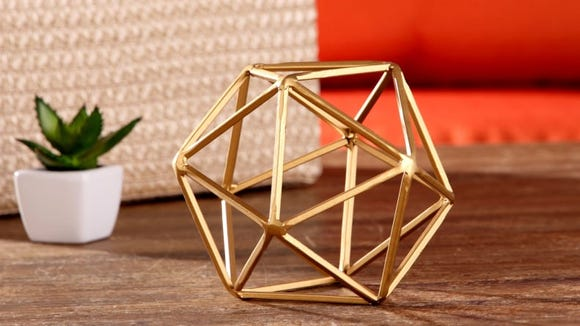 This cool geometric decoration would be a unique paperweight.