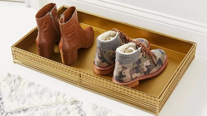 This beautiful metal boot tray is as stylish as they come.