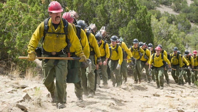 """Eric Marsh (Josh Brolin, front) leads the Granite Mountain Hotshots up the trail at Yarnell Hill in Columbia Pictures' """"Only the Brave."""" The film, based on the 2013 deaths of Arizona's Granite Mountain Hotshots, was filmed in New Mexico."""