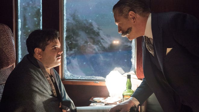 "Personal assistant Hector MacQueen (Josh Gad) is questioned by super-sleuth Hercule Poirot (Kenneth Branagh) in the Agatha Christie adaptation ""Murder on the Orient Express."""