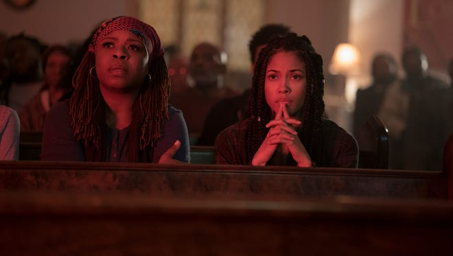 "Mugga (left) and Lex Scott Davis star in ""The First Purge."""