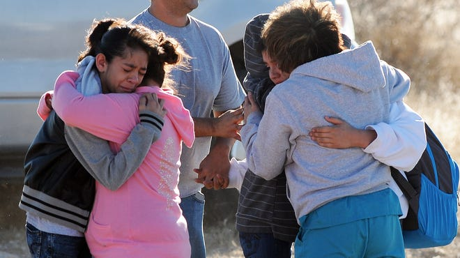 Students are reunited with family after a shooting at Berrendo Middle School on Jan. 14, 2014, in Roswell, N.M.