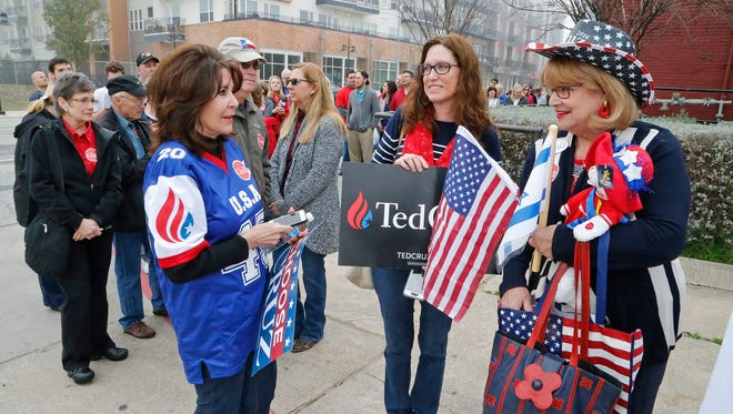 Suzanne Blackstone and Debbie Edwards of Plano, Texas, and Diane Benjamin, right, of Dallas, wait in line to enter a building where Republican presidential candidate Sen. Ted Cruz was to hold a rally in Dallas on Feb. 29, 2016.