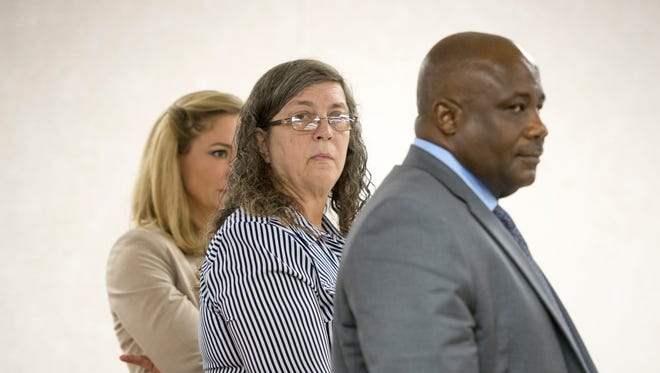Milton day care provider Thelma Lowery, center, and her attorneys stand as the jury enters the room during her trial in the Santa Rosa Courthouse in Milton on Tuesday, Aug. 8, 2017. Lowery faces charges in connection to the death of a 15-month-old in her care.