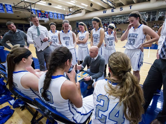 Waukesha West head coach Mark Busalacchi draws up a