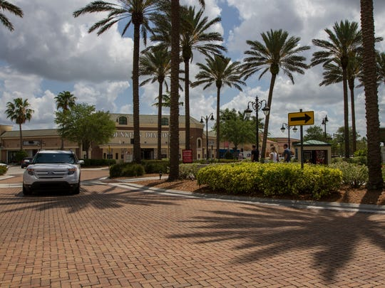 Visitors to Gulf Coast Town Center make their way past