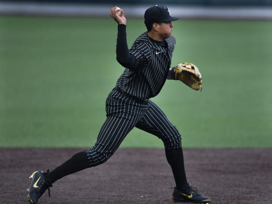 Vanderbilt third baseman Jayson Gonzalez (99) makes