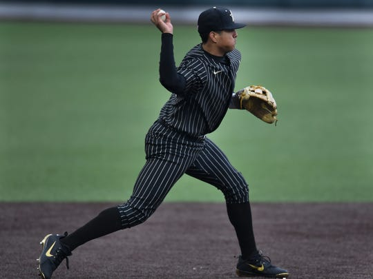 Vanderbilt third baseman Jayson Gonzalez (99) makes a throw to second base for an out during the game against Duke at Hawkins Field Friday, Feb. 16, 2018 in Nashville, Tenn.