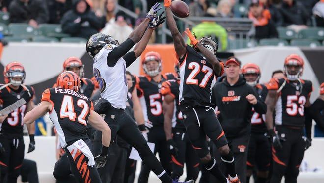 Cincinnati Bengals cornerback Dre Kirkpatrick (27) breaks up a pass intended for Baltimore Ravens wide receiver Breshad Perriman (18) in the fourth quarter during the Week 17 NFL game between the Cincinnati Bengals and the Baltimore Ravens, Sunday, Jan. 1, 2017, at Paul Brown Stadium in Cincinnati.