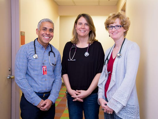 Dr. Veenod Chulani (left), Dr. Sarah Beaumont and Dr. Michelle Huddleston provide specialized care to LGBT and homeless youth as a part of Phoenix Children's Hospital's adolescent medicine department.