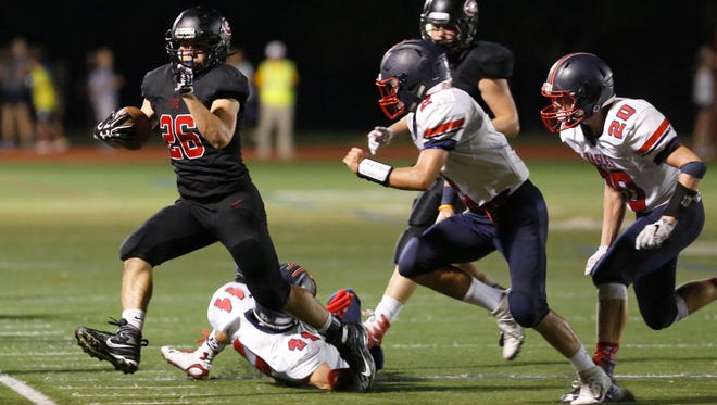 Eastchester defense goes after Rye's Will Tepedino during a football game Sept. 23, 2016 at Rye High School.