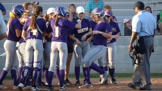 Benton celebrates Sarah Koeppen's two-run homer in the fourth inning against North DeSoto Thursday evening.