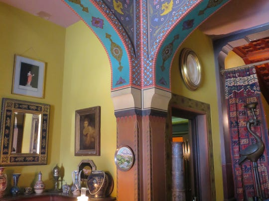 Stenciled designs decorate arches in the mansion at